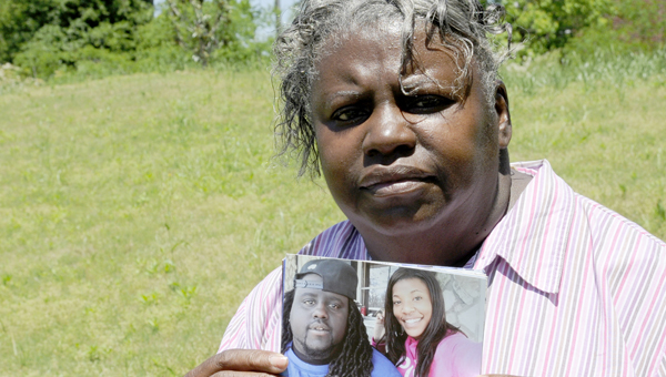 Patricia Robinson holds a photograph that includes her son, Andre Robinson.  Andre was shot and killed during a robbery on April 22.  No suspects have been identified in the 32-year-old's murder. -- Sarah Robinson
