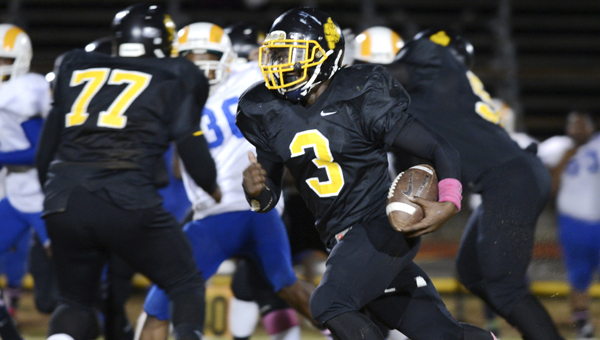 Ellwood Christian's Rayford Mitchell runs the ball in a game last season against Akron. Mitchell scored a touchdown in the Eagles' 12-6 victory over J.F. Shields Wednesday at Memorial Stadium. --File Photo