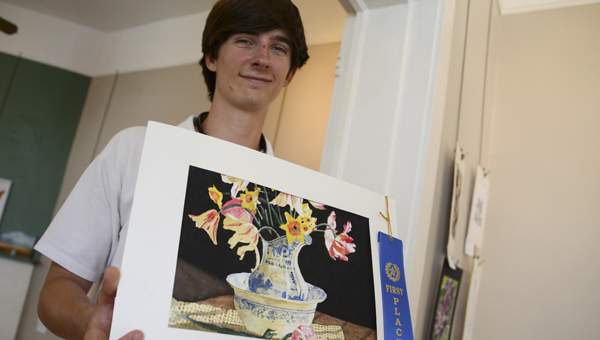 Matt Rester poses with his water color painting that recently won the Selma Art Guild's Student Art Show.  Rester is a senior at Morgan Academy. -- Jay Sowers