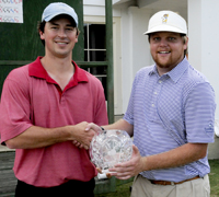 Selma Country Club Invitational tournament director Dr. Logan Tucker presents the Invitational trophy to 2014 winner Jake Greer, right, Sunday afternoon. -- Dennis Palmer