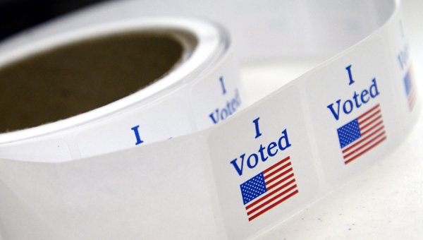 A spool of voting stickers wait to be handed out Tuesday morning at the polling place at the Central Alabama Fairgrounds.