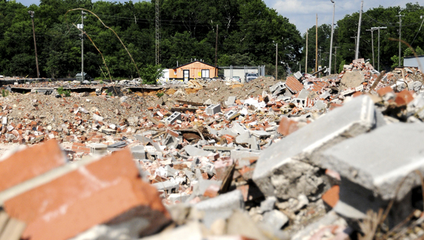 The site of the former Stewart-King-McKenzie Building is home to scattered bricks and other building materials. The building was demolished by Cooper Brothers months ago,  but debris still needs to be hauled away.--Josh Bergeron