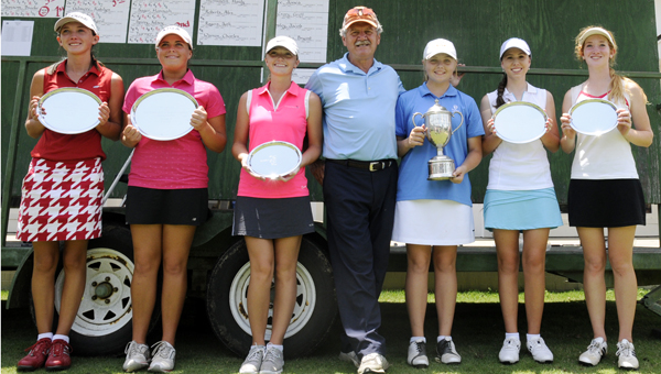 Tommy Burns, center, presented the top three winners for the girls age divisions as well as the overall winner Tuesday afternoon. Kelsey Spivey, far left, was the 2nd place winner for the 16-18 girls' division.  Ashton Maddaloni, second from left, was the 1st place winner for the 16-18 girls division. Madison Sanders, third from left, was the 3rd place winner for the 13-15 girls division Brooke Samson, third from right, was the overall winner of the tournament as well as the 13-15 winner.  Alyssa Burnette, second from right, was the 2nd place winner for 13-15 girls division.  Anna Fasshact, far right, was the 3rd place winner for the 13-15 girls division.