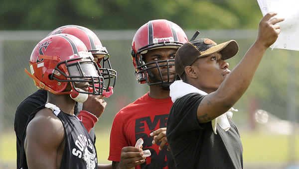 A Southside High School football coach talks with some of Southside's players during last year's 7-on-7 scrimmage. Southside will a 7-on-7 scrimmage Tuesday, June 24.