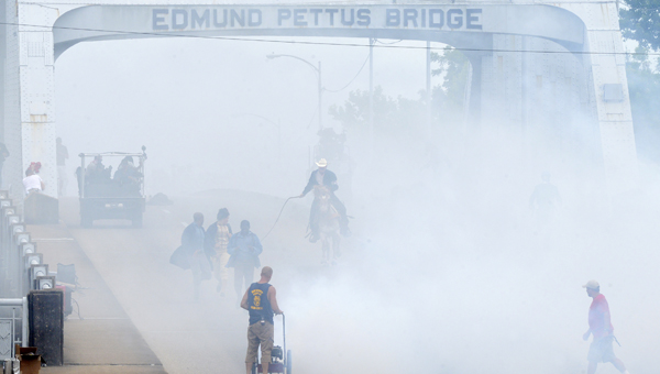 """A cloud of theatrical smoke hangs over the Edmund Pettus Bridge during the filming of a scene for the movie """"Selma"""" early Thursday afternoon. --Jay Sowers"""
