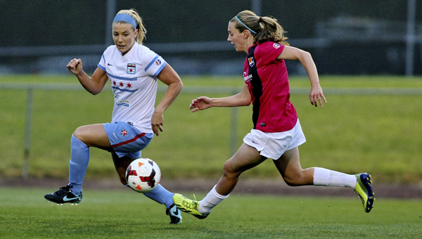 Selma resident Katy Freels of Sky Blue FC, left, kicks the ball past an opponent in a game earlier this season. Freels, who has scored four goals this season, and her husband Kevin, moved to Selma in July 2013 and love the small town atmosphere.-- Robyn McNeil   Sky Blue FC