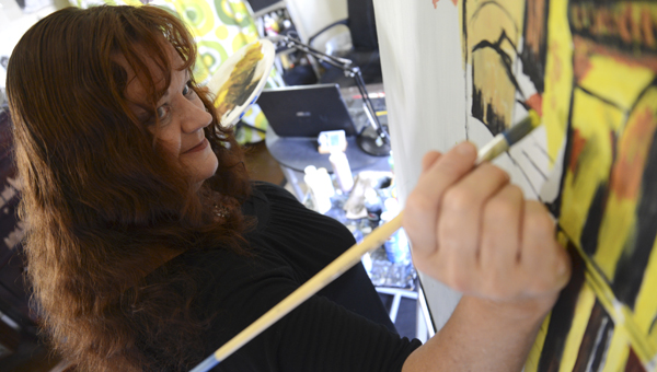 Plantersville artist Kathleen McQueen Wright works on a painting in her studio Wednesday morning.--Jay Sowers