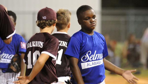 Hayden Roberts shakes hands with his opponents after a tough 10-0 loss at the Dallas County Sportsplex Friday night.