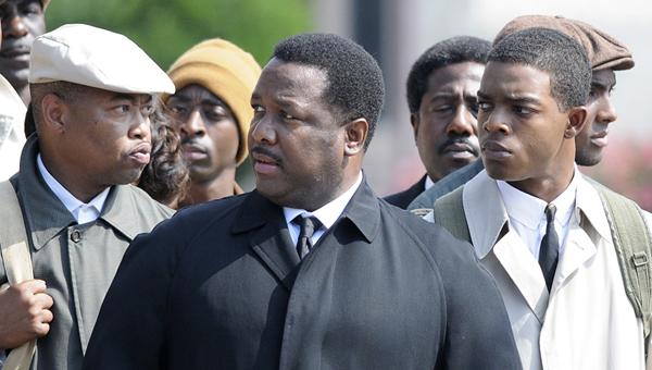 """Above, actor Wendell Pierce, center in black coat, is portraying Hosea Williams in the movie """"Selma,"""" currently being filmed in downtown Selma. At right is actor Stephan James, who is portraying U.S. Rep. John Lewis."""