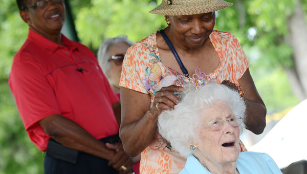 Selma resident Mallieve Breeding waves to an onlooker Saturday during the Butterfly Awareness Day event at the Selma Farmers Market. Breeding was named the first Butterfly Queen during Saturday's event. (Jay Sowers | Times-Journal)