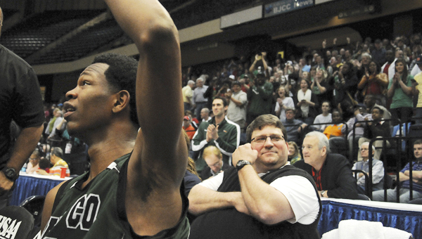 Dallas County's Willliam Lee, left, celebrates the Hornets' Class 4A state championship in March at the Birmingham Jefferson Convention Complex, as Marty Smith, right, looks on. Smith accepted the Hornets' head football position earlier this month.--File Photo