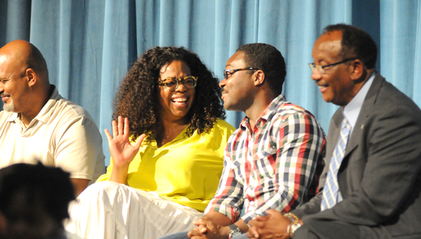"Oprah Winfrey shares a laugh Sunday with David Oyelowo at Selma High School Auditorium during a town hall meeting. ""Selma"" the movie hosted the town hall meeting to answer questions about the film. (Josh Bergeron 