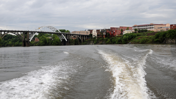 Selma's iconic downtown riverfront and Edmund Pettus Bridge is seen from the back of a boat on the Alabama River. -- Daniel Evans