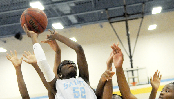 Selma High School's Areyana Williams shoots the ball against Booker T. Washington. Williams led the Saints with eight points in the 30-minute game. -- Christopher Edmunds
