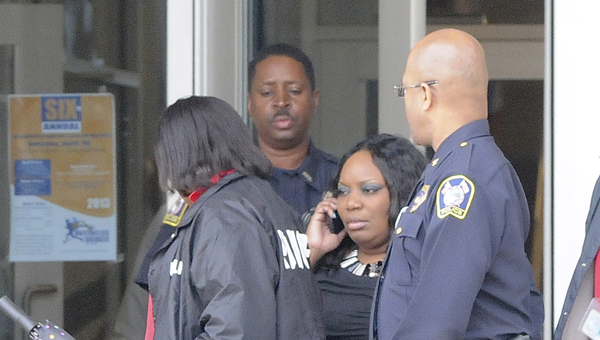 not over yet: LaTanglia Williams is escorted out of Selma High in April 2013. Her Sunday release resulted in two different court motions being filed. (File Photo | Times-Journal)