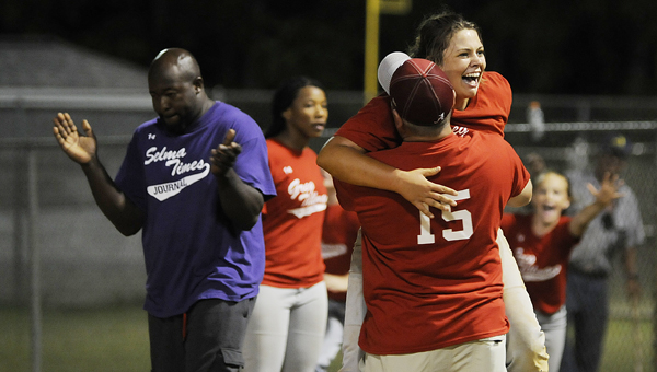 Greg Tillman State Farm's Shelby Boswell hugs coach Bubba Holley during Monday night's come-from-behind victory over Selma Times-Journal at the Dallas County Sportsplex. Greg Tillman trailed by nine runs after three innings, but rallied for a 19-16 victory to clinch the 15-and-under youth softball championship.--Christopher Edmunds