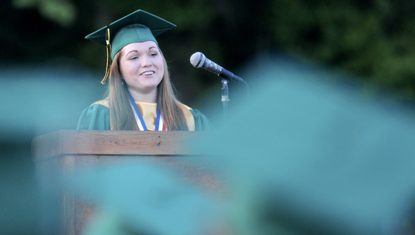 Tayler Fancher, the valedictorian for Dallas County High School's Class of 2014, delivers her speech during her class' graduation ceremonies in May.--Daniel Evans