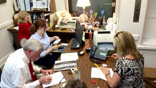 Dallas County Probate Judge Kim Ballard (bottom left) and his staff count voting results Tuesday. (Tim Reeves | Times-Journal)