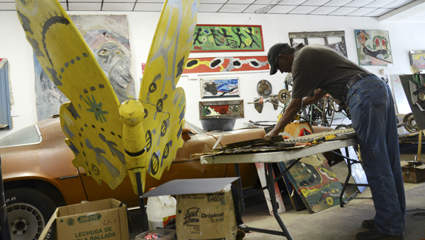 Charlie 'Tin Man' Lucas works on his next piece of art in his Broad Street workshop. -- Jay Sowers