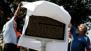 Selma Mayor George Evans and April 1865 Society President James Hammonds unveil a historical marker Wednesday in preparation for the 150th anniversary of the Battle of Selma. (Josh Bergeron | times-Journal)