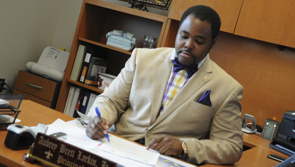 Selma High Principal Aubrey Larkin Jr. works at his desk Tuesday afternoon. Selma High is one of many schools located in the Dallas County area preparing for the return of students this upcoming 2014-2015 school year.