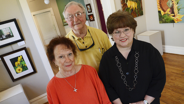 Selma Art Guild members, left to right, Shirley Quarles Baird, Roy Childers and Cam Guarino pose for a photograph in the in guild's Selma Avenue gallery. The guild hosted its first art show in the gallery twenty years ago this week. (Jay Sowers | Times-Journal)