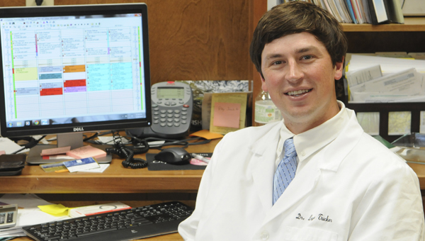 Dr. Logan Tucker
