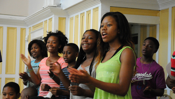 Members of the Tabernacle Baptist Church youth choir rehearse Thursday evening to learn new songs for an upcoming Sunday performance. (Christopher Edmunds | Times-Journal)