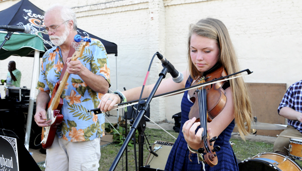 Veigh Kaye Spencer plays fiddle for The Grasshopper Stringband at the Jazz on the Grazz festival in Selma.