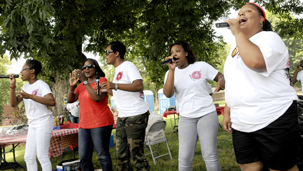 The Love City Praise Team sings during the Selma Strong Rally Saturday afternoon. Held at George Washington Carver Homes, the event meant to celebrate unity attracted more than 100 people.--Sarah Robinson