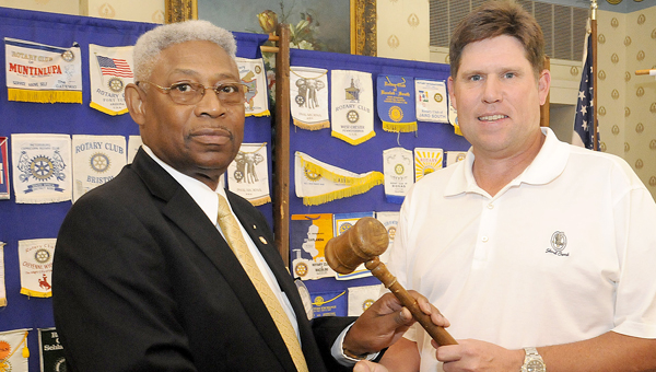 Christopher Edmunds | Times-Journal new leader: Outgoing president of Rotary Selma-Dallas County Troy Harvill (right) passes the honorary gavel to incoming president McNair Ramsey (left).