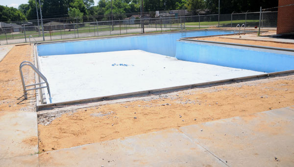 unfinished: Broken bits of concrete were removed from the Dinkins Pool earlier this month, but one city councilman is worried that construction won't be finished in time for his original deadline. (Josh Bergeron | Times-Journal)