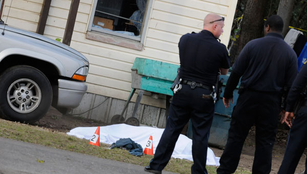 Police stand over the the body of Ananias Shaw following a December officer-involved shooting.  Shaw was pronounced dead on the scene.  A grand jury decided last week that the officer acted correctly during the incident. (Josh Bergeron | Times-Journal)