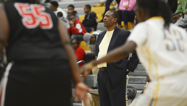 Selma High School girls' basketball coach Anthony Harris shouts instructions to his team during a game against Sumter Central last season. --File Photo