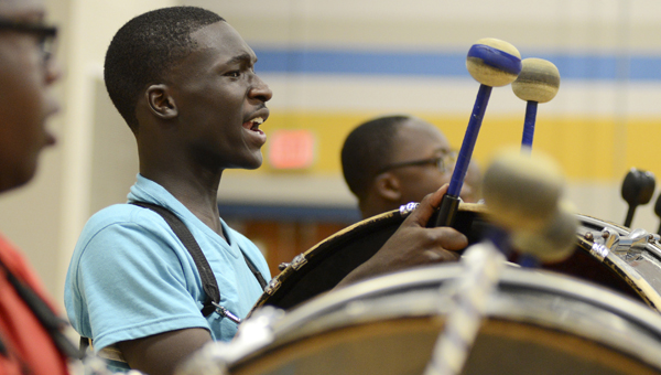 Selma High School junior JaVonte Benjamin calls out his steps during band practice Tuesday morning. (Jay Sowers | Times-Journal)