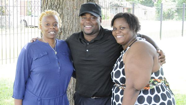 "Erica Heard, T.J. Davis and Regina Wilkes stand under the ""Tree of Life"" Wednesday at Selma University. Daniel Evans   Times-Journal)"