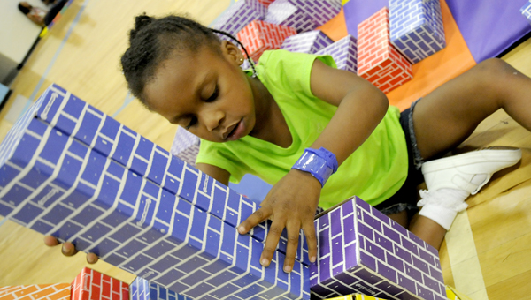 """Australia McQueen plays with the blocks in the """"Books, Blocks & Balls"""" room during Friday's Community Family Fun Festival at Selma High School's gymnasium. -- Scottie Brown"""