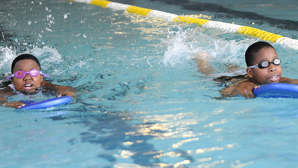 Swimmers were taught different swim strokes Tuesday during the YMCA of Selma-Dallas County's swim team practice. (Daniel Evans | Times-Journal)
