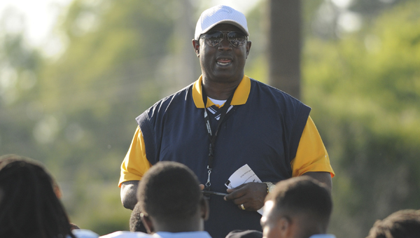 Selma head coach Leroy Miles talks to his team after its spring game earlier this year. The Saints play only two teams this season that won more than five games last year. --File Photo