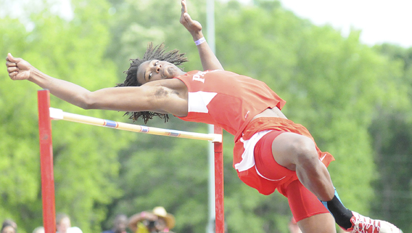 coming up short: Linden High School's Kynard Craig soars over the pole during the high jump competition at the 2014 AHSAA state track championships at Memorial Stadium.  (Daniel Evans | Times-Journal)