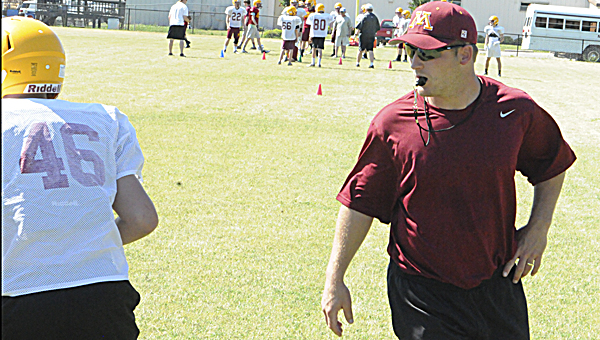 Morgan Academy head coach Jake Wingo directs players at a spring training practice earlier this year.  Wingo and the Senators are working out four times a week this summer, with two of those workouts taking place at Selma CrossFit.--File Photo