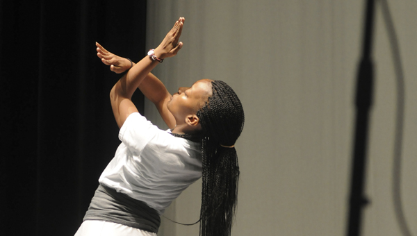Selma High alumni Marissa Moore, with Shiloh Baptist Church, performs a praise dance Thursday morning during Selma City Schools' praise and worship portion of the 2014-2015 Employee Institute. (Sarah Robinson   Times-Journal)