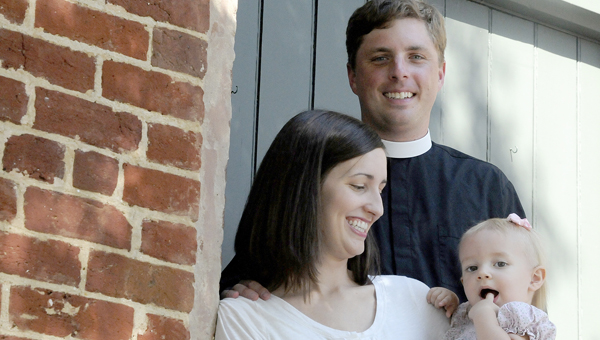 Pastor Jack Alvey, middle, poses for a photo with his wife Jamie, left, and daughter Mary Katherine, right, Friday at the St. Paul's Episcopal Church on Lauderdale Street. He accepted a call to serve as the rector of the church and his first sermon will be Sunday at 8 a.m. with an additional sermon at 10 a.m. (Sarah Robinson | Times-Journal)