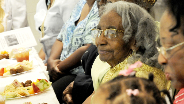 Orrville native Elizabeth Brown, center, celebrated her 100th birthday with  friends and family Sunday at her church, Calvary Missionary Baptist Church. (Sarah Robinson |Times-Journal)