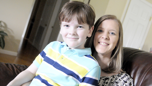 Making a difference: Jay McWherter and his mother Kaylee McWherter pose for a picture Friday in their Selma home. Jay was born with cystic fibrosis and for the second year, Kaylee has organized a fundraising event to support the Cystic Fibrosis Foundation. (Tim Reeves | Times-Journal)