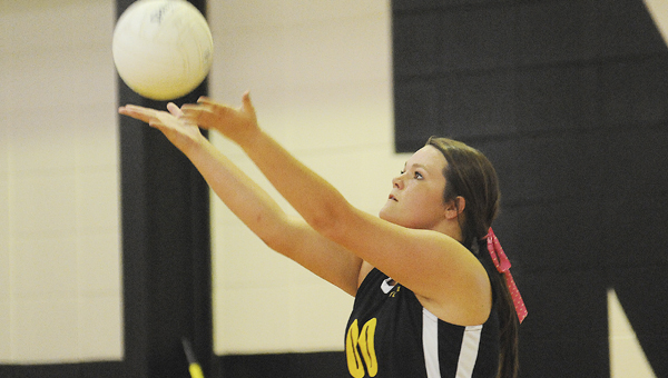 Meadowview's Claudia Kendrick serves the ball in Thursday's game against Marion Academy. --Daniel Evans