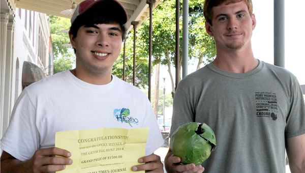 Michael Ward and Dallas Prescott pose with the gator egg and certificate that earned them the $1,500 Gator Egg grand prize. (Josh Bergeron | Times-Journal)