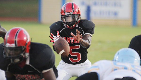 Southside quarterback Scott Cole takes a snap in last week's game against Selma. Cole is expected to get the start for the Panthers again this week versus Keith as starting quarterback Khamari Gibbs is likely to miss the game with a hamstring injury. (Daniel Evans | Times-Journal)