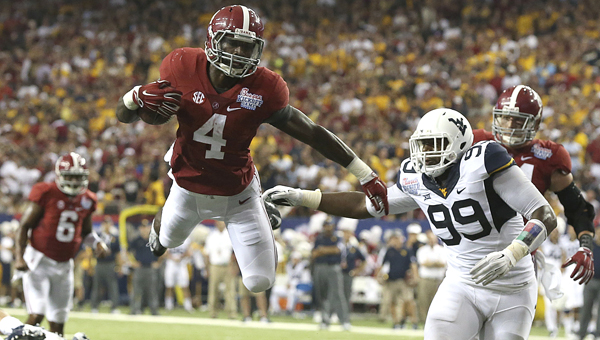 Alabama running back T.J. Yeldon dives into the end zone during the Crimson Tide's 33-23 opening win over West Virginia at the Georgia Dome in Atlanta. Yeldon ran for 126 yards and two touchdowns in Alabama's victory. -- Kent Gidley | University of Alabama