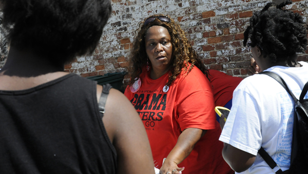 "I Have a Dream Celebration organizer Queen Tate feeds guests Thursday at Phoenix Park. The event is designed to celebrate the 51st anniversary of Civil rights activist Martin Luther King Jr.'s ""I Have Dream"" speech. -- Sarah Robinson"